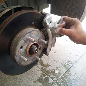 cleaning the brake calipers
